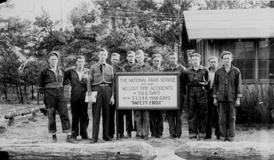 Group of CCC workers by NPS safety sign.