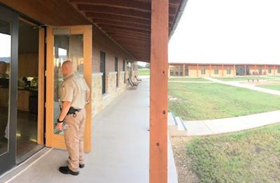 Cadet walking into a dormitory entrance