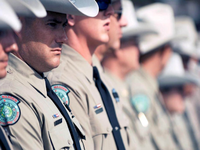 Game Wardens at funeral honoring their lost brother