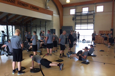 Cadets working out inside gymnasium