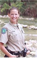 Female Game Warden in uniform while outdoors