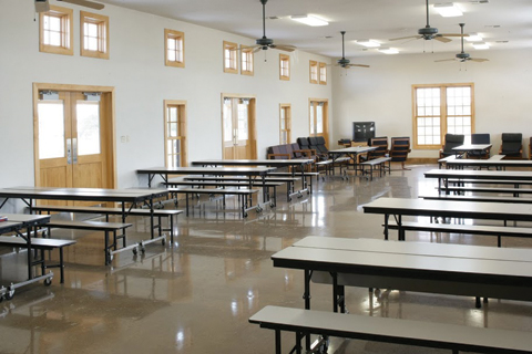 Color photograph of the inside tables of the cafeteria
